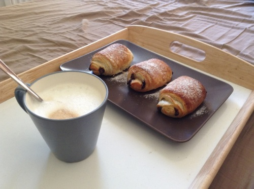 This, on the other hand, is pure heaven -- pain au chocolat straight from the oven with a latte for breakfast in bed.